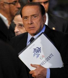 ITALY-G8-BERLUSCONI-LOGO-PRESSER
