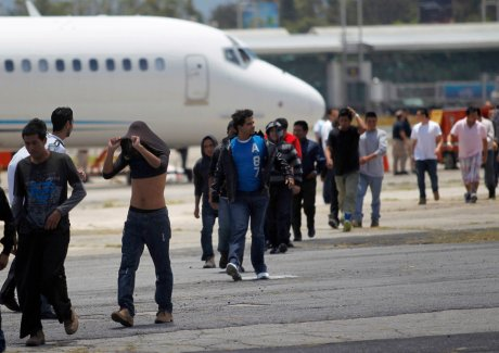 Illegal migrants from Guatemala, deported from Phoenix, Arizona in the U.S., arrive at an air force base in Guatemala City
